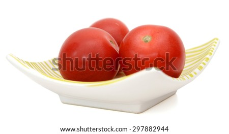 freshly red mini tomatoes on plate isolated on white  - stock photo