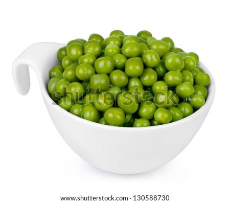 Freshly shelled green peas, in white bowl. - stock photo