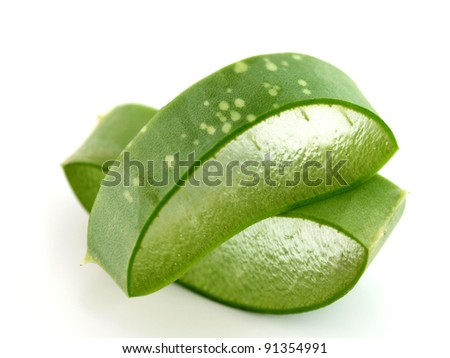 Freshly sliced Aloe Vera showing green skin and juicy texture, on white background. Fresh Aloe Vera is natural remedy for sunburn relief and cure many things - stock photo