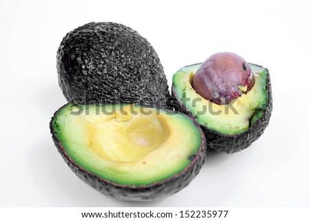 Freshly sliced avocado isolated on white.