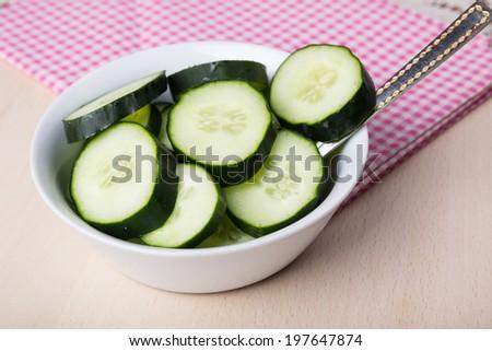 Freshly sliced cucumber, close up photo - stock photo