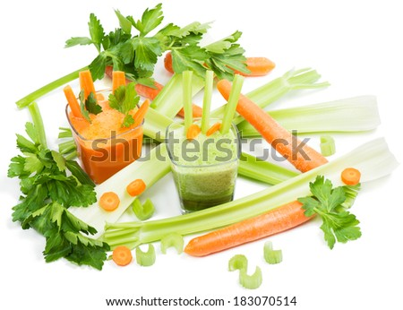 Freshly squeezed carrot and celery juices, carrots, leaves of celery. Isolated on white background - stock photo