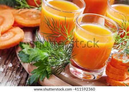 Freshly squeezed Carrot smoothie, dark background, selective focus - stock photo