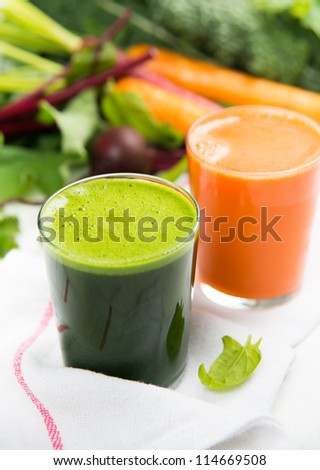 Freshly Squeezed Greens and Carrot Juices - stock photo