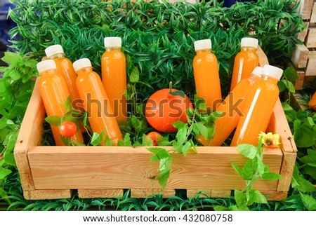 Freshly squeezed orange juice is sold in plastic bottles - stock photo
