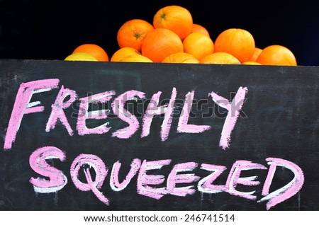 Freshly squeezed orange on display in food market. - stock photo