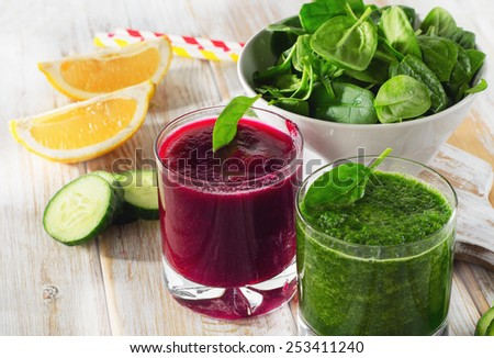 Freshly Squeezed Vegetable Juices on a wooden table. - stock photo