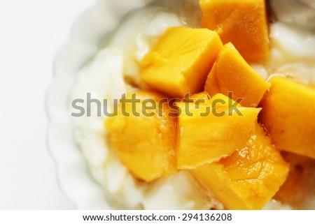 Freshness mango and honey on yogurt - stock photo