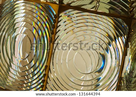 fresnel lens of lighthouse beacon as abstract background - stock photo