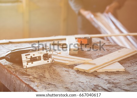 fretsaw measuring tape and tongue and groove boards on working place closeup