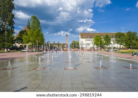 FREUDENSTADT, GERMANY - MAY 20, 2009: Playing children at the lower market place with fountains in Freudenstadt in the Black Forest, Baden-Wurttemberg, Germany, Europe
