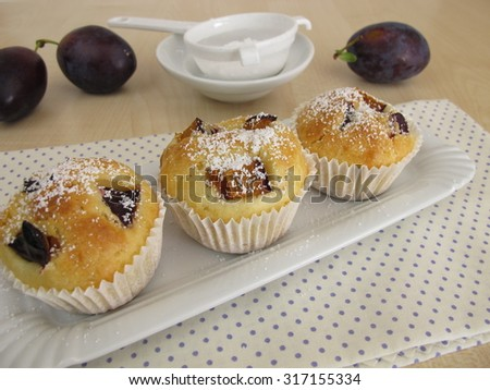 Friands with plums - stock photo
