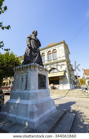 FRIBOURG, SWITZERLAND - SEPTEMBER 10, 2015: Statue of Gregoire Girard, Jean-Baptiste Girard, known as Father Girard (1765 - 1850), located at Place des Ormeaux in front of the Basilica of Our Lady  - stock photo