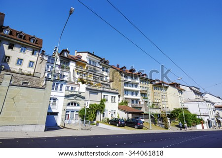 FRIBOURG, SWITZERLAND - SEPTEMBER 10, 2015: Urban scene of architecture of the capital city of the canton of Fribourg, which shares two linguistic regions between German and French cultures - stock photo