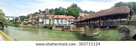 FRIBURG, SWITZERLAND - JUNE 16, 2015: Bern Bridge (Pont de Berne). The last covered wooden bridge in Fribourg dates back to 1653. One of the few remaining wooden bridges.  - stock photo