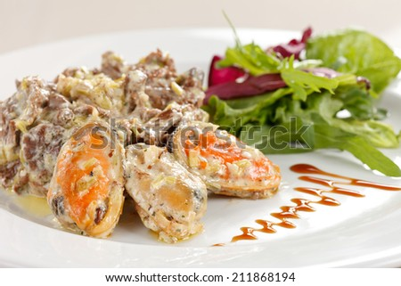 Fricassee with seafood and salad - stock photo