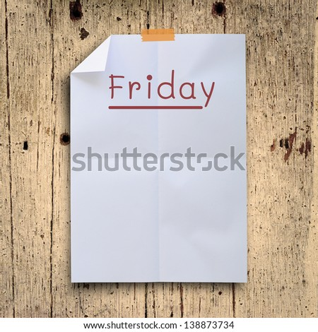 Friday planning on white fold paper with grunge retro wall panels. - stock photo