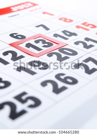 Friday 13th is framed  on the calendar. - stock photo