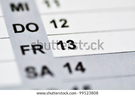 Friday the 13. on a calendar. Sphere blurred - stock photo