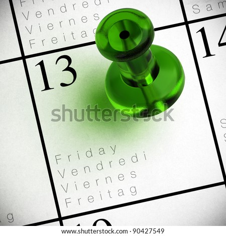 friday the 13th written onto a multilingual calendar with a red thumbtack with transparency - stock photo