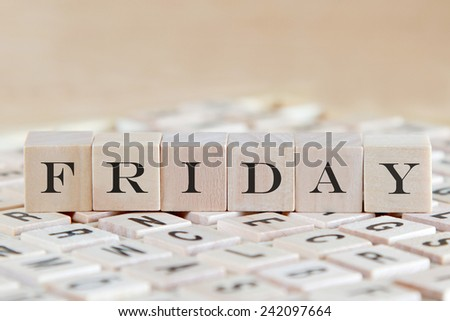 friday word on wooden cube - stock photo