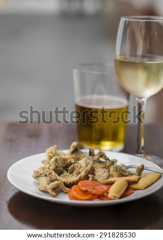 fried anchovies, white wine and beer at a street bar, Seville, Spain - stock photo
