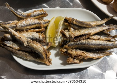 Fried anchovies with lemon served as tapas. Spanish boquerones fritos - Shot taken in Canary Island   - stock photo