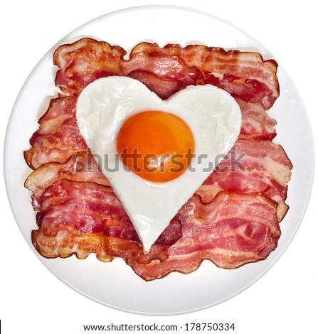 fried bacon with egg  in shape of heart on a plate top view surface  isolated on white background - stock photo