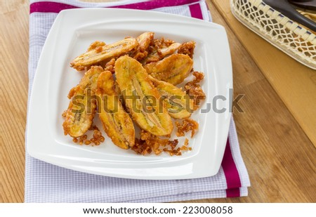 Fried Banana, Banana Deep Fried, Thai snack, Deep fried sliced banana, banana fried, Traditional Desserts food in Thailand.  - stock photo