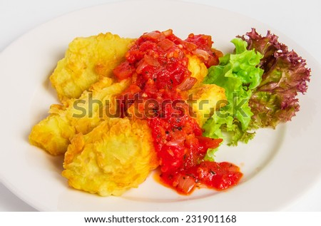 Fried battered fish fillet. Telapiya in batter with marinara sauce on white plate - stock photo
