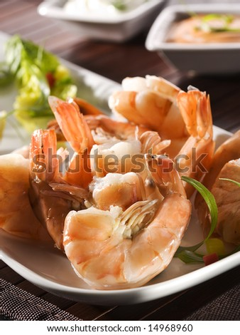 fried black tiger prawns on plate with salad garnish and dip sauces