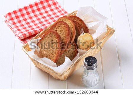 fried bread with garlic in a strawy basket - stock photo