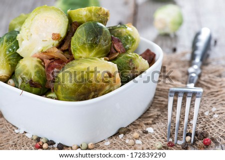 Fried Brussel Sprouts with Ham and Onions - stock photo