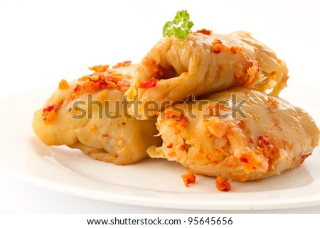 fried cabbage stuffed with meat on a white background