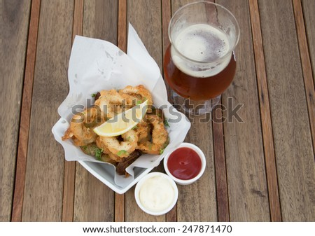 Fried calamari, fried squid with Beer - stock photo