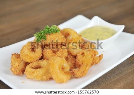 Fried Calamari Rings with Sauce Bowl  - stock photo