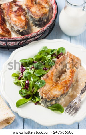 fried carp with milk-onion sauce