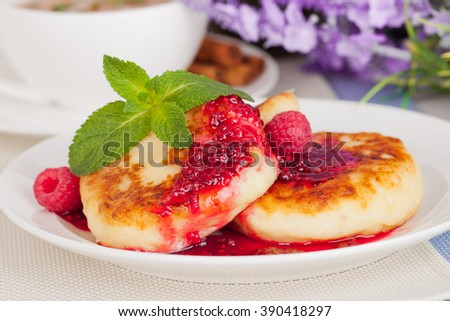 fried cheese cakes pancake with raspberry jam and mint