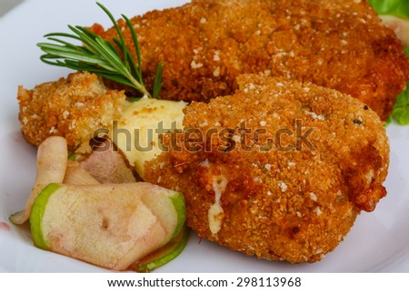 Fried cheese sticks in pan with rosemary - stock photo