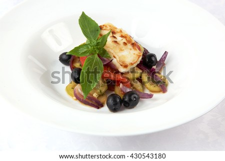 Fried cheese with vegetables on plate - stock photo