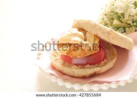 fried chicken and English muffin sandwich - stock photo