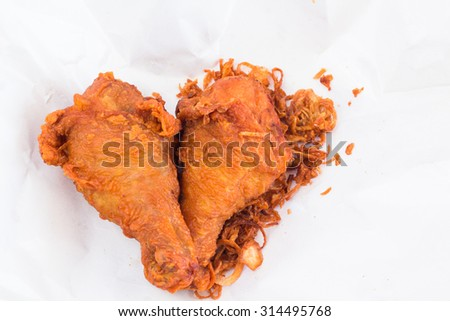 "Fried chicken as Thai style (Thai menu call name ""Hat Yai fried chicken"" on plastic wrap. - stock photo"