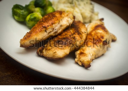 Fried chicken breast meal with brussel sprouts and mashed potatoes - stock photo