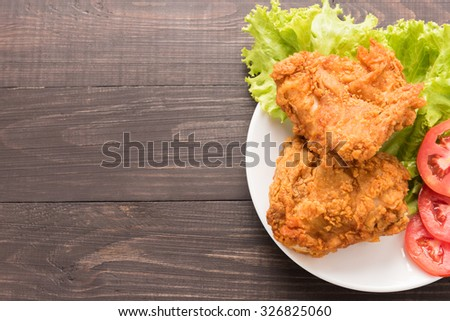 Fried chicken breast on a wooden background. - stock photo