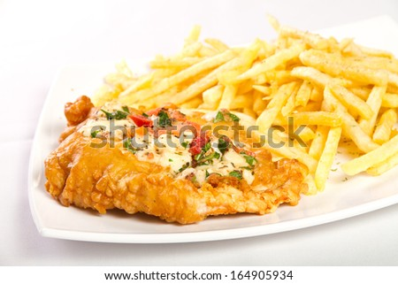 Fried chicken breast with fries - stock photo