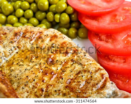 Fried chicken fillets  and vegetables - stock photo