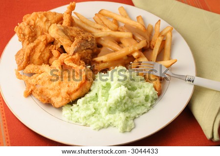 fried chicken, french fries with gravy and coleslaw dinner