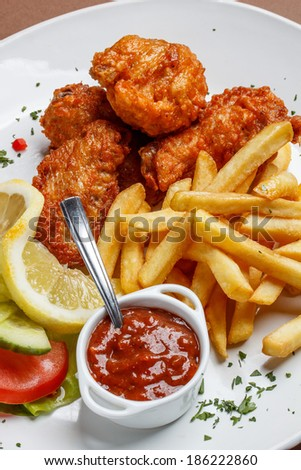 Fried chicken legs with french fries - stock photo
