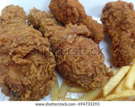Fried Chicken legs with french fries.