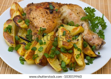 Fried chicken legs with potato served on the white plate - stock photo